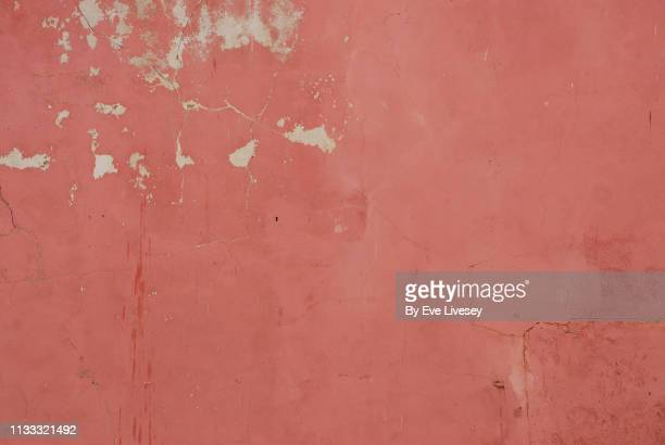 pink painted wall texture - chipping stock pictures, royalty-free photos & images