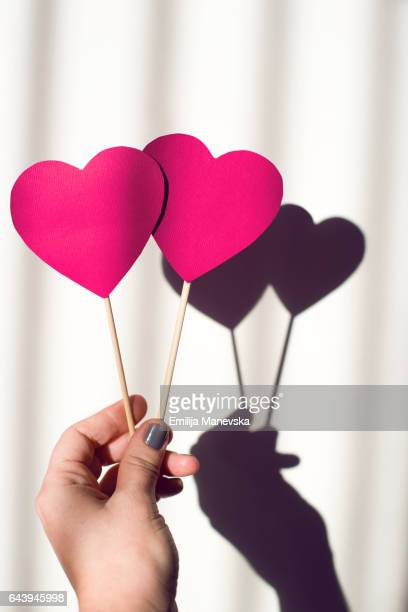 pink paper heart - heart month stock photos and pictures