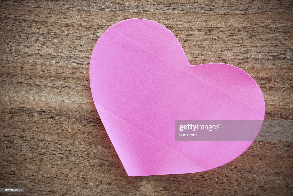 Pink paper heart shape on wood background : Stock Photo