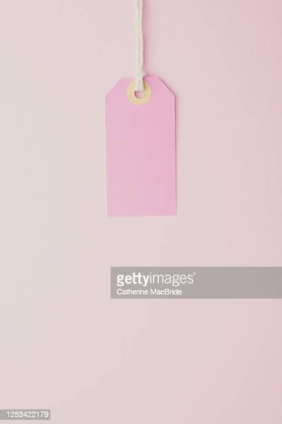 pink paper label on a pink background - catherine macbride stock pictures, royalty-free photos & images