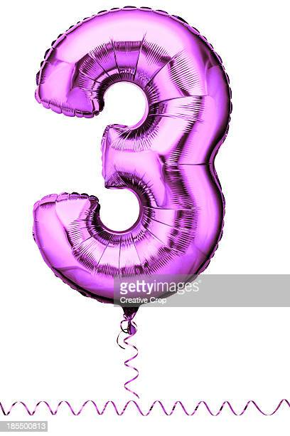 Pink party balloon in the shape of a number three