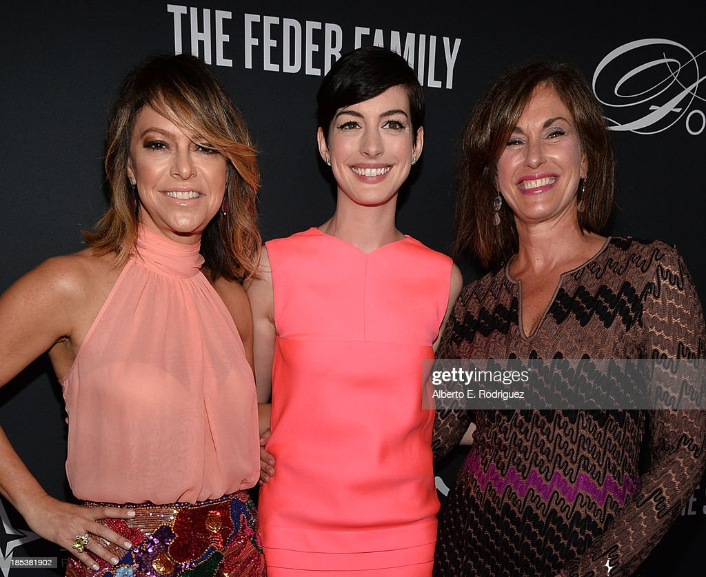 Pink Party Founder Elyse Walker, host Anne Hathaway, and Dr. Beth Y. Karlan, M.D., Director of Cedars-Sinai Women's Cancer Program attend Elyse Walker Presents The Pink Party 2013 hosted by Anne Hathaway at Barker Hangar on October 19, 2013 in Santa Monica, California.