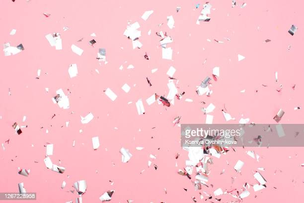 pink pastel festive background with confetti and sparkles. flat lay style. - silver coloured stock pictures, royalty-free photos & images