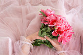 pink peony flowers bouquet female hands