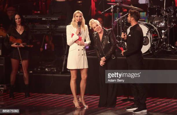 Pink performs during the 'The Voice of Germany' semifinals next to Lena Gercke and Thore Schoelermann at Studio Berlin Adlershof on December 10 2017...