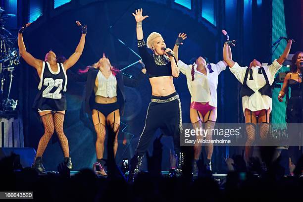 Pink performs on stage in concert at Manchester Arena on April 14 2013 in Manchester England
