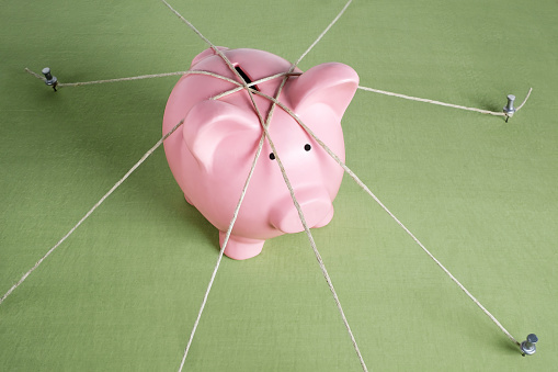 Pink Piggy Bank Tied Up - gettyimageskorea