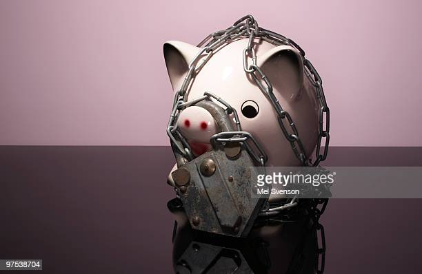 Pink piggy bank wrapped in chains