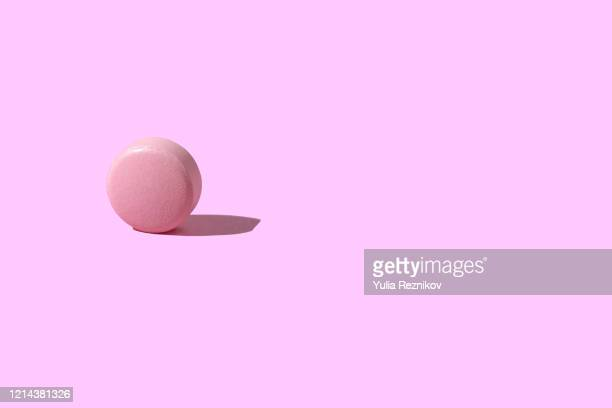 pink pill on pink background - pills stock pictures, royalty-free photos & images
