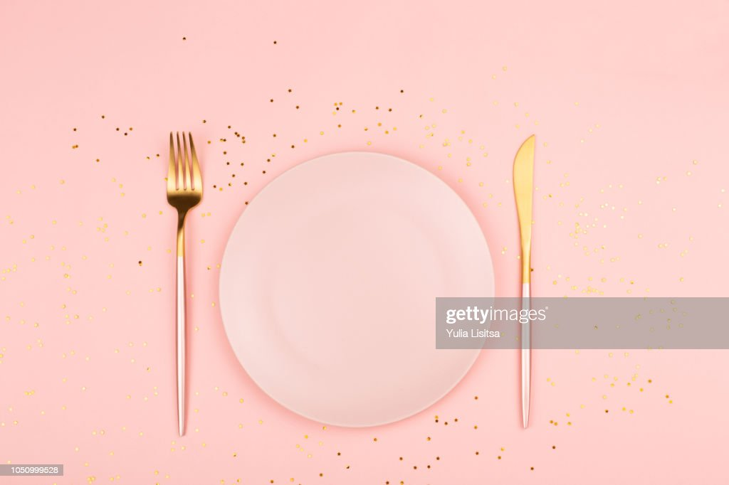 Pink plate and cutlery : Stock Photo