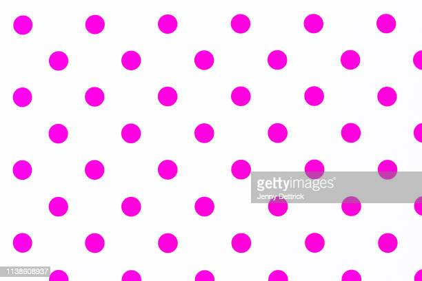 pink polka dots - spotted stock pictures, royalty-free photos & images