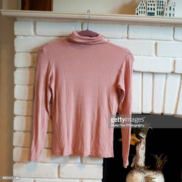 Pink polo-neck jumper