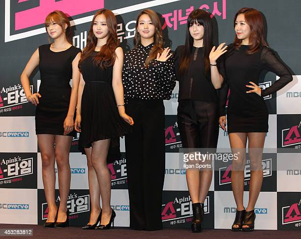A pink pose for photographs during the MBC Everyone 'A pink's Show Time' press conference at CGV on August 6 2014 in Seoul South Korea