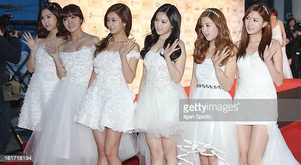 A pink pose for photographs upon arrival during '2nd Gaonchart Kpop Awards' at Olympic Hall on February 13 2013 in Seoul South Korea