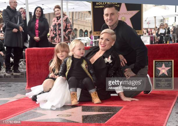 Pink poses with husband Carey Hart and children Willow Hart and Jameson Hart at a ceremony honoring her with the 2656th star on The Hollywood Walk of...