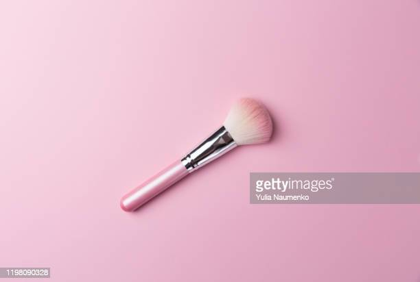 pink professional makeup brush for powder and eye shadows, isolated on pink background. - メイクアップブラシ ストックフォトと画像