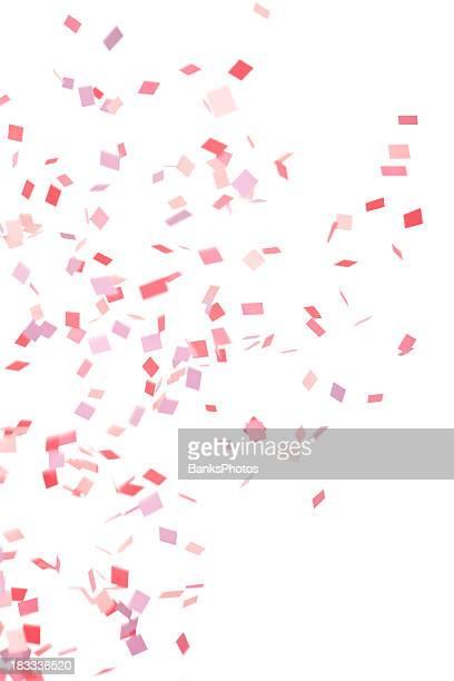 ピンク、パープル、赤の紙ふぶきフォーリング、白で分離