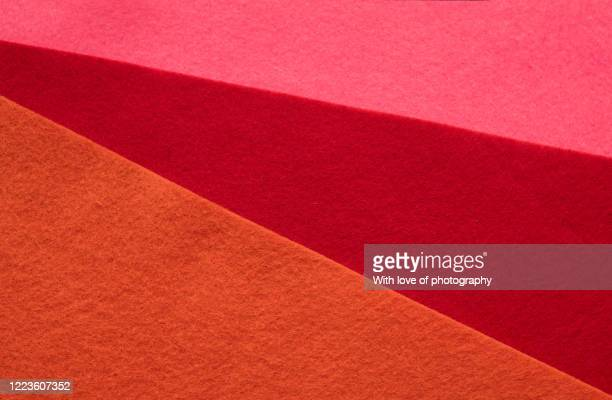 pink, red and orange felt sheets texture background - felt stock pictures, royalty-free photos & images