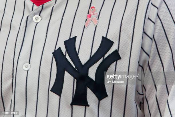 A pink ribbon in honor of Mothers Day is seen on the uniform of Chad Green of the New York Yankees after the seventh inning against the Oakland...