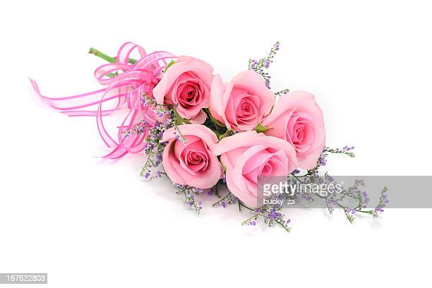Pink rose bouquet and mauve foliage isolated on white background