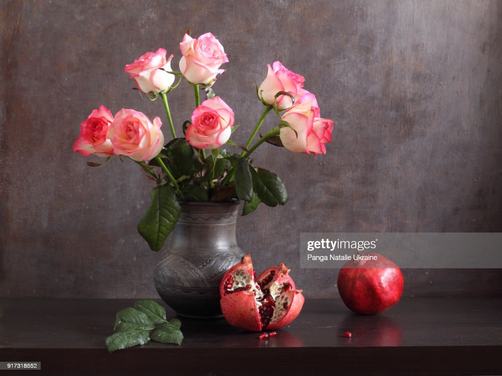 Pink Rose Bouquet And Pomegranates Stock Photo Getty Images