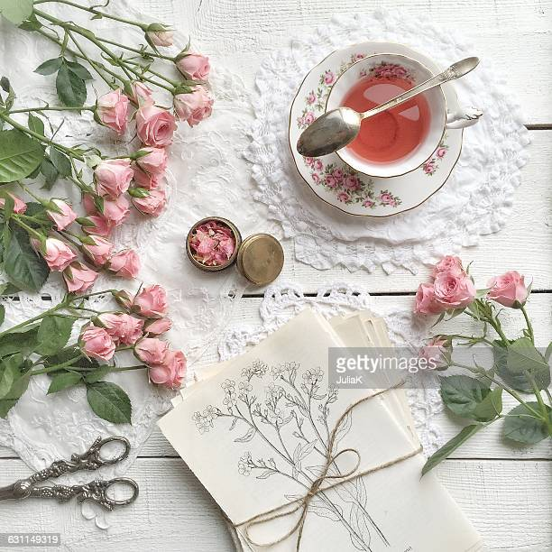 pink roses and cup of tea - julia rose stock photos and pictures