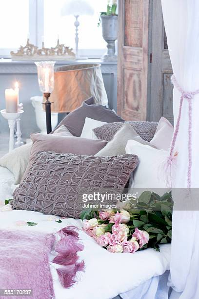Pink roses on bed