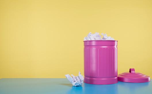 pink rubbish bin full of crumbled paper - gettyimageskorea