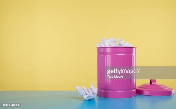 pink rubbish bin full of crumbled paper - garbage bin stock pictures, royalty-free photos & images