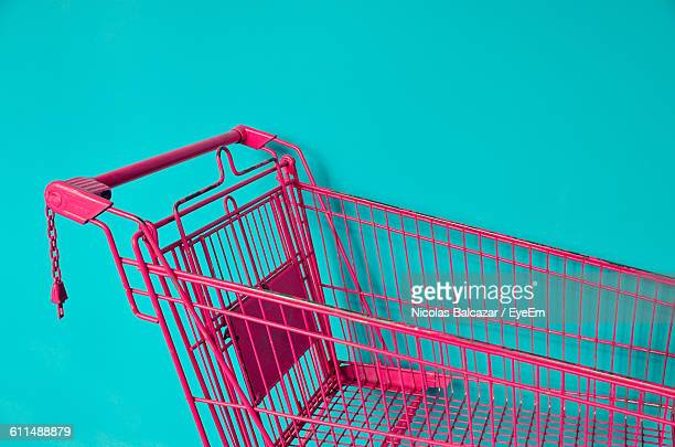 Pink Shopping Cart Against Colored Background