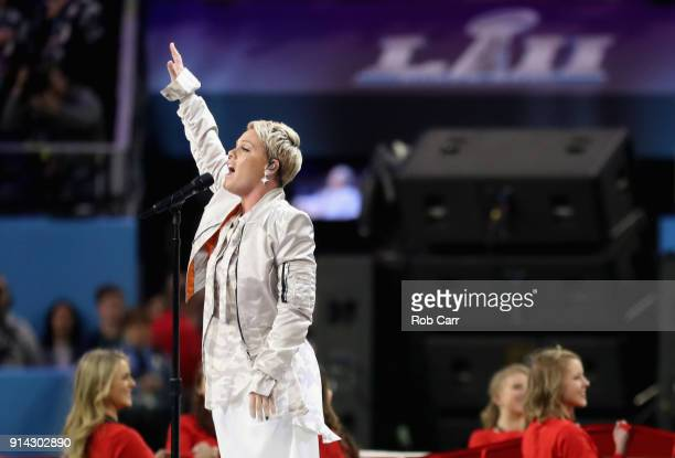 Pink sings the national anthem prior to Super Bowl LII between the New England Patriots and the Philadelphia Eagles at U.S. Bank Stadium on February...