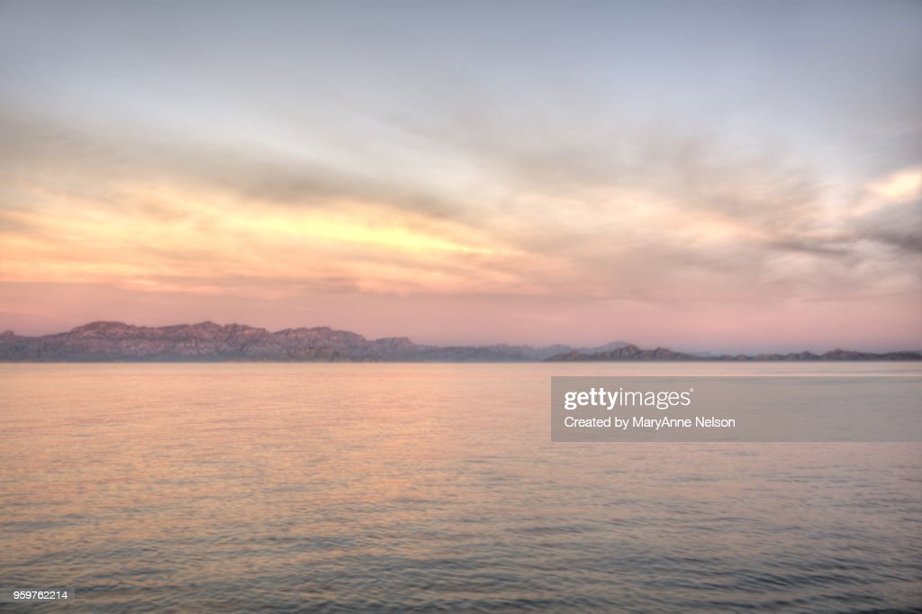 Pink Sky and Water with Land : Stock-Foto