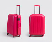 Pink small luggage bag side and front view isolated on white