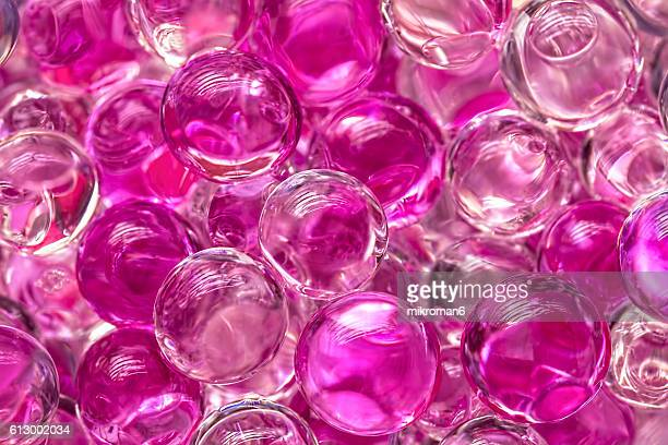 pink sparkling pearls background - gel effect lighting stock photos and pictures