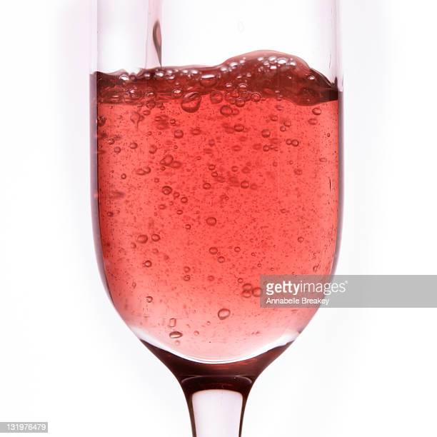 Pink Sparkling Rose Wine poured into Wine Glass