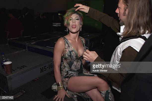 Pink sticking her tongue out as she gets her hair adjusted backstage at the 2000 Billboard Music Awards in Las Vegas Nevada December 5 2000