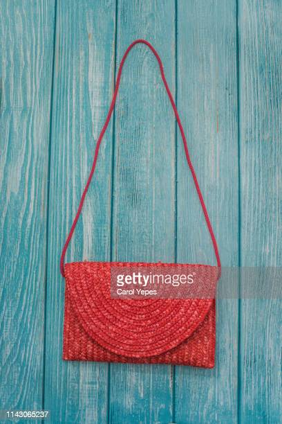 pink straw bag in blue wooden background - brown purse stock pictures, royalty-free photos & images