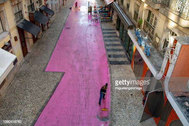 pink street after a party day - cleaning after party imagens e fotografias de stock
