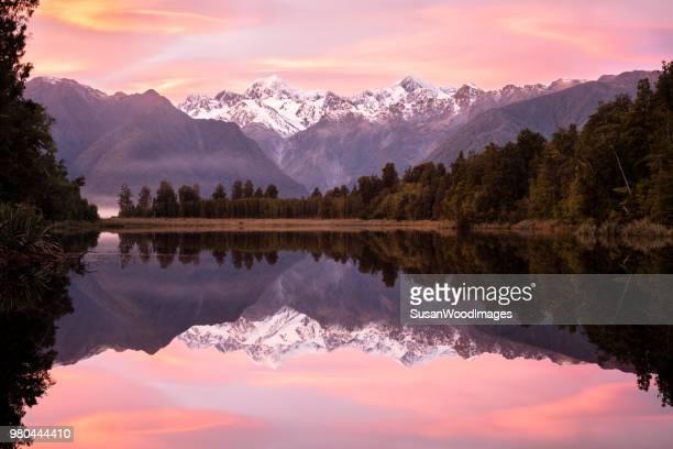Pink sunrise Lake Matheson, New Zealand