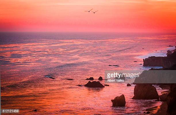 pink sunset color over malibu b\beach - malibu beach stock pictures, royalty-free photos & images