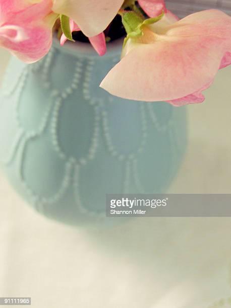 Pink sweat peas. blue vase