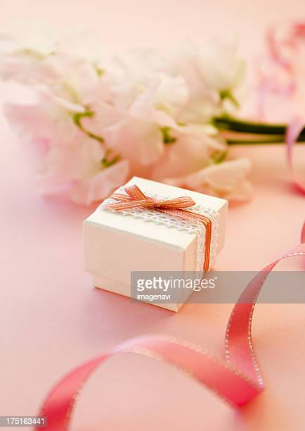 Pink sweet peas and a gift box