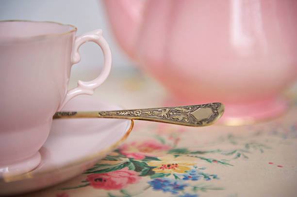 Pink teapot and cup of tea