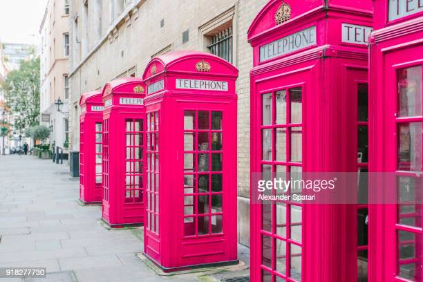 Pink telephone booth in London, England, UK