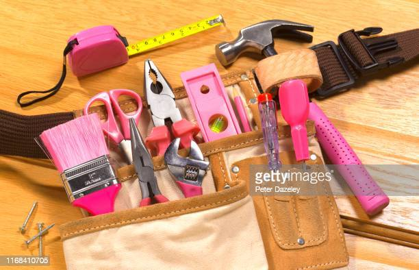pink toolbelt ready for maintenance work - politics and government stock pictures, royalty-free photos & images