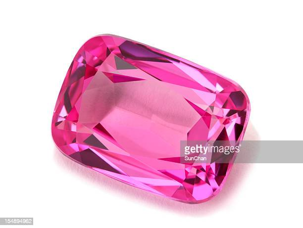 Pink tourmaline gemstone isolated on a white background