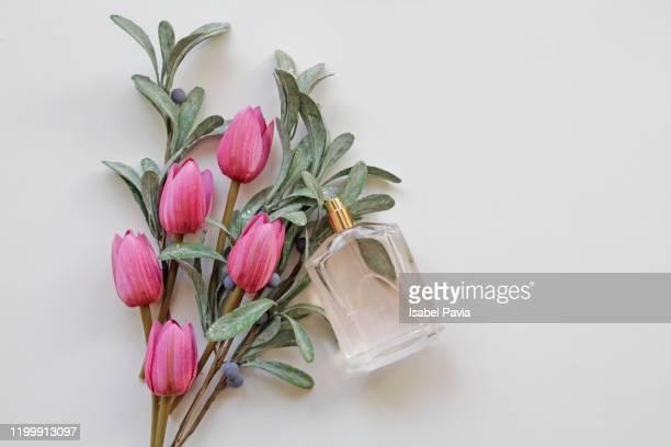 pink tulips bouquet and perfume bottle - 芳香 ストックフォトと画像