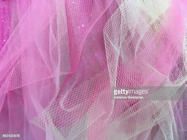 pink tulle netting fabric, full frame - netting stock pictures, royalty-free photos & images