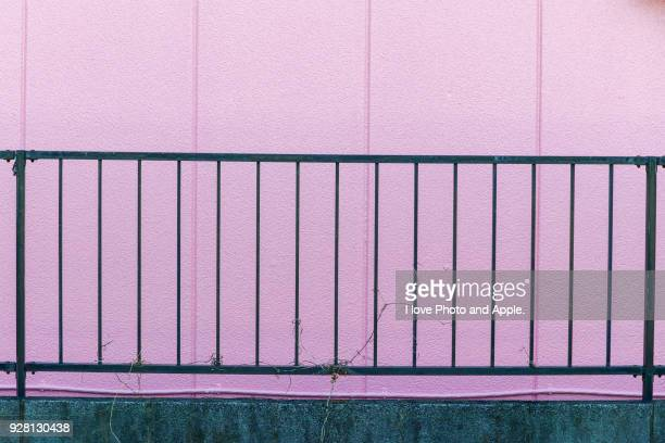 Pink wall and fence