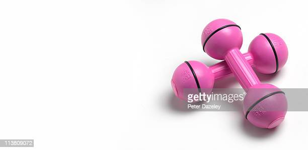 Pink weight training dumbbells with copy space